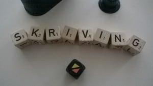 Buchstabenwürfel skriving